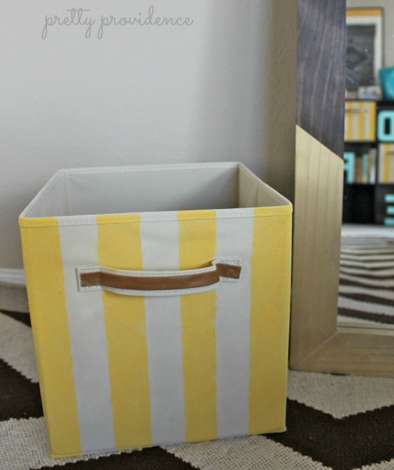 give your plain storage bins a quick makeover with a little bit of paint! candy striped bins DIY by pretty providence