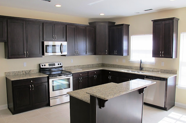 awesome l shaped kitchen with hardwood espresso kitchen cabinets with small bar island and white granite glossy tops