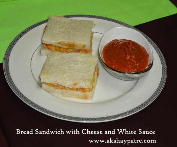 Bread sandwich with cheese and white sauce ready to serve