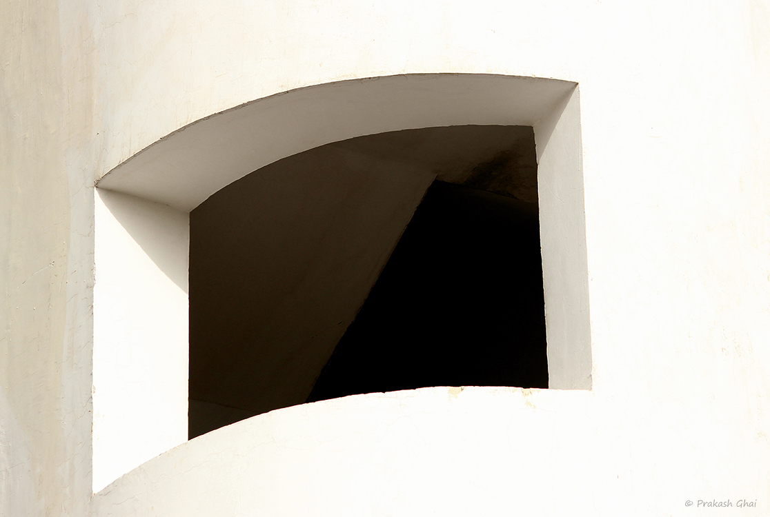 A Minimalist Photo of a Curvy geometric Window at a Design Institute in Jaipur, reinstating that curves are beautiful.