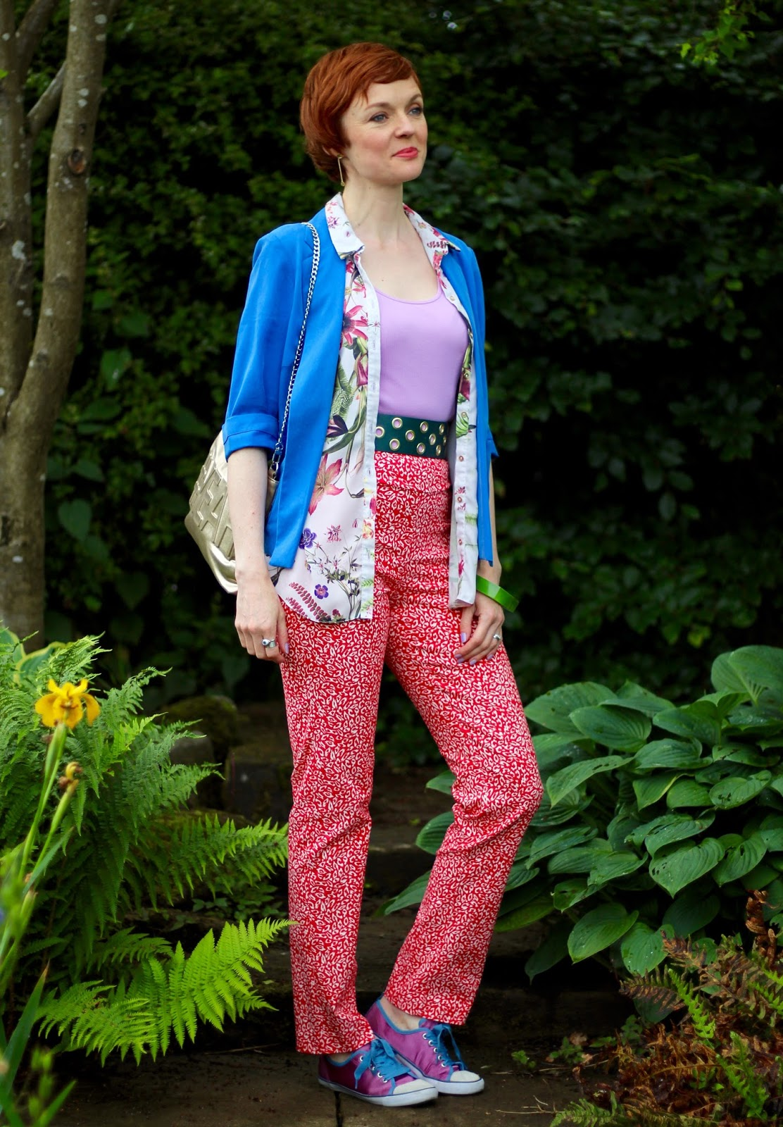 Samantha Blair of Fake Fabulous fashion blog wears two summery prints with a pair of adorable purple sneakers.