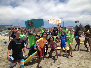 Large group of campers and their camp counselor on the beach at Aloha Beach Camp