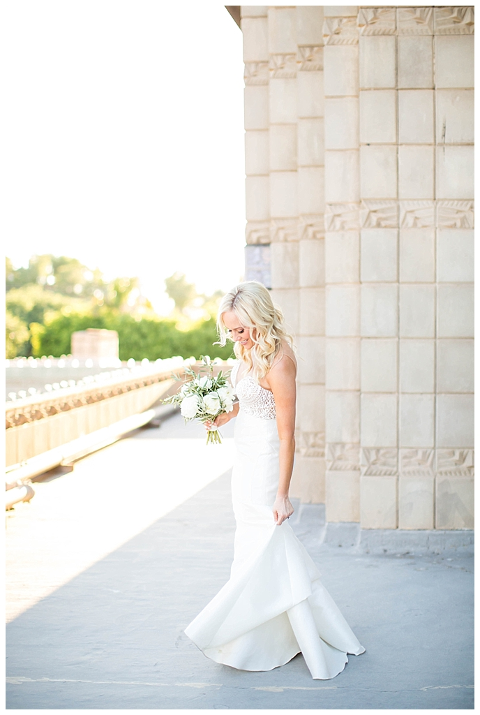 bride in two piece wedding dress on the rooftop at Arizona Biltmore