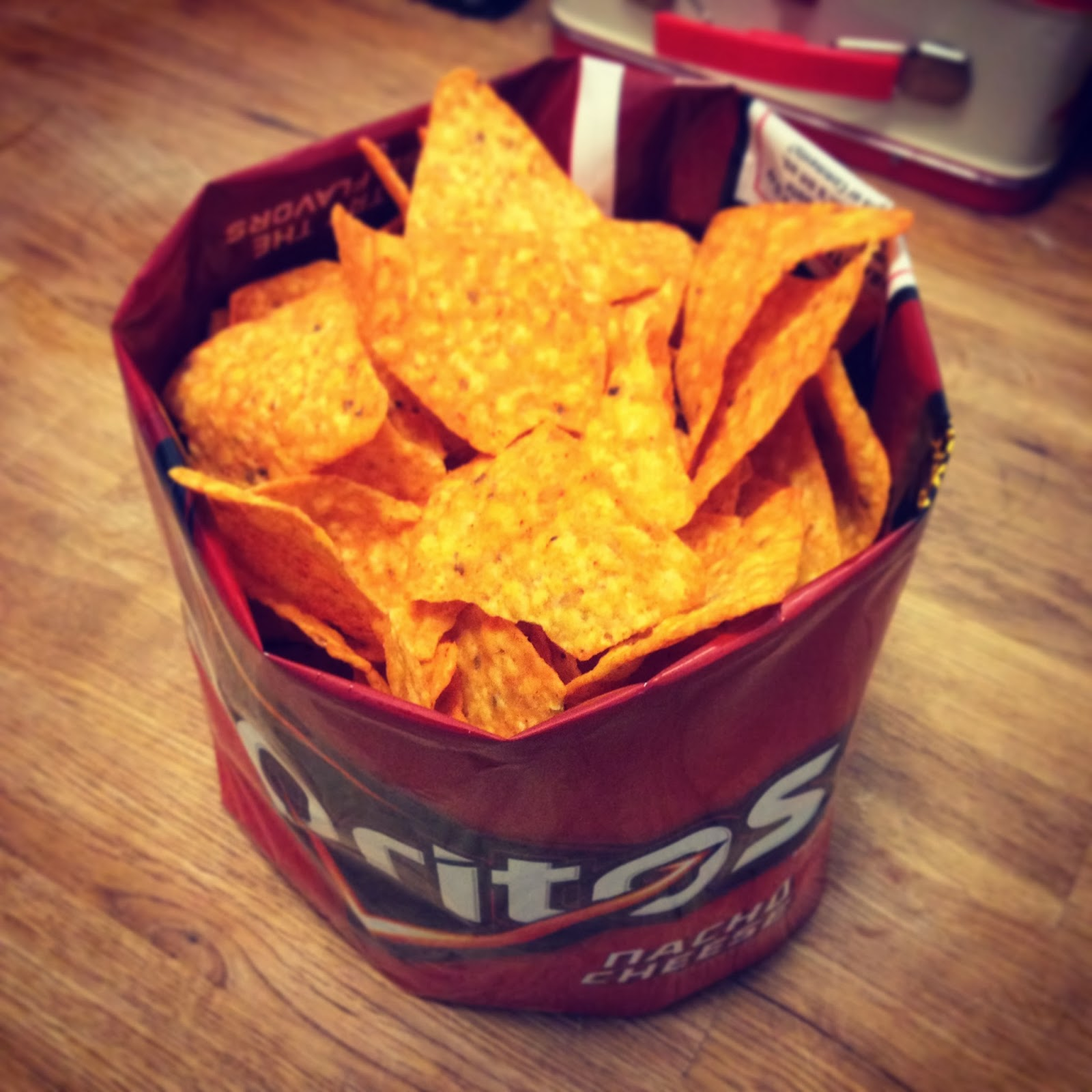 Then roll and tuck the bottom corners up into the base of the bag and push  up so the chips are overflowing. 8a32a00228c85