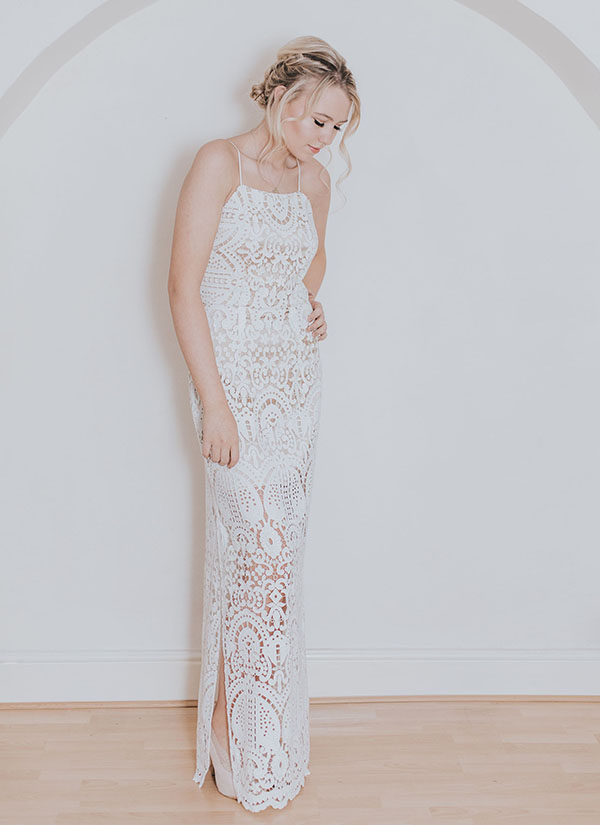 This stunning crochet lace wedding dress is one of many wedding dresses from She Wore Flowers. This wedding gown has spaghetti straps and a slit in the skirt.