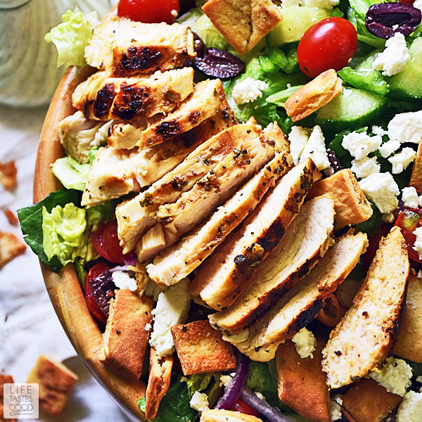 Gyros salad with chicken in a large wooden serving bowl