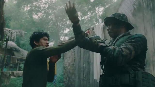 Two men fight in a jungle