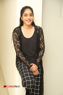 Actress Punarnavi Bhupalam Stills in Black Dress at Pittagoda Press Meet  0045.JPG