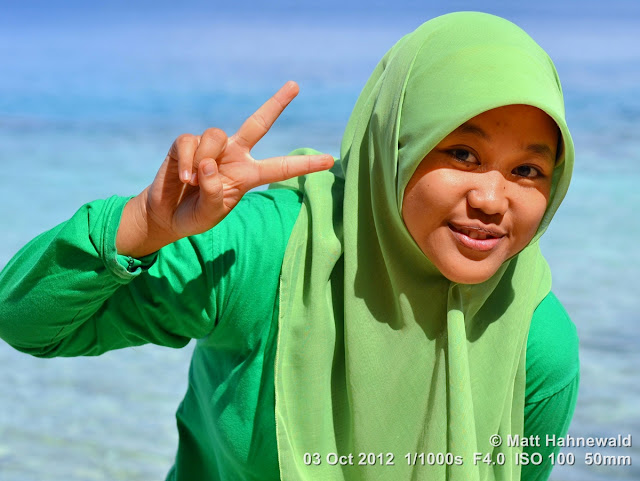 street portrait, Indonesia, Central Sulawesi, V sign, Indonesian Muslim lady, green hijab, beach, charming, outgoing, smiling, posing