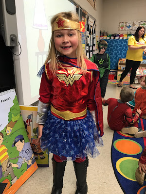 Young girl dressed as super woman