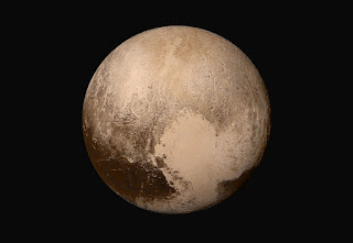 Image of Pluto's heart holds clues about an underwater ocean  on the dwarf planet. Credit: NASA/JHUAPL/SwRI