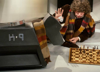 Tom Baker as The Doctor plays chess with K-9 in the BBC show 'Doctor Who'