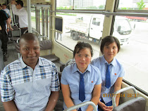 "Banele Nyamane of Malawi on public tram in Pyongyang, with a couple of friendly local ""props"""