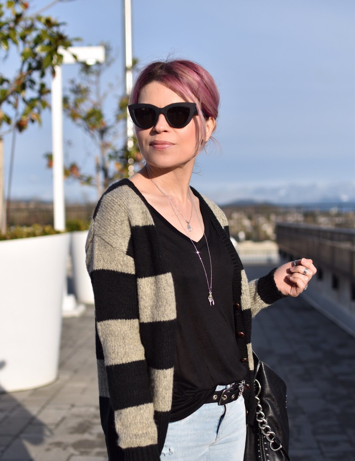 Monika Faulkner outfit inspiration - striped grandpa cardigan, slouchy tee, cat-eye sunglasses