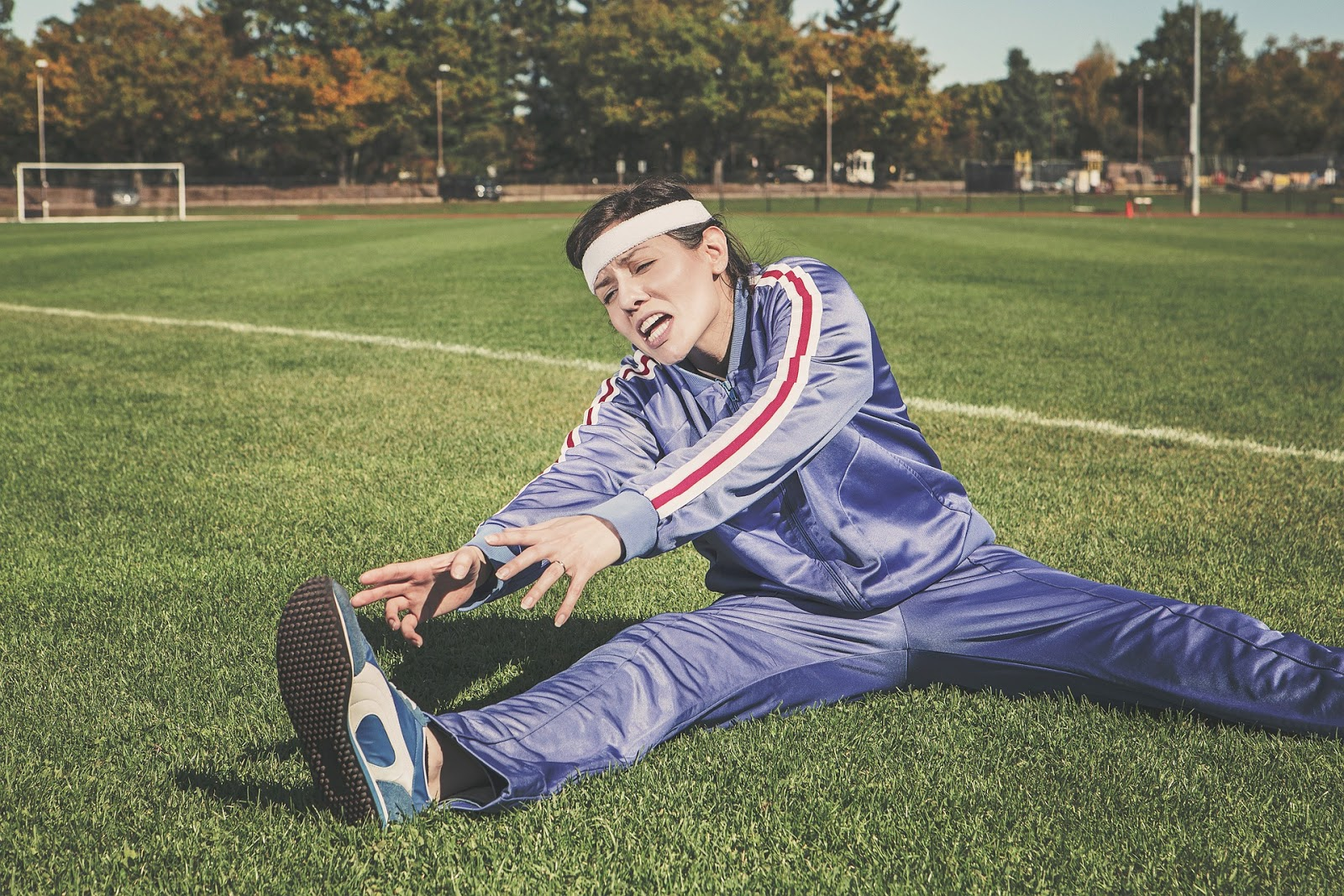 Woman stretching in pain