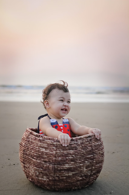 happy baby in a basket captured by mamatha photography