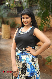 Actress Model Poorni Stills in Floral Long Dress at Silk India Expo Launch  0017.JPG