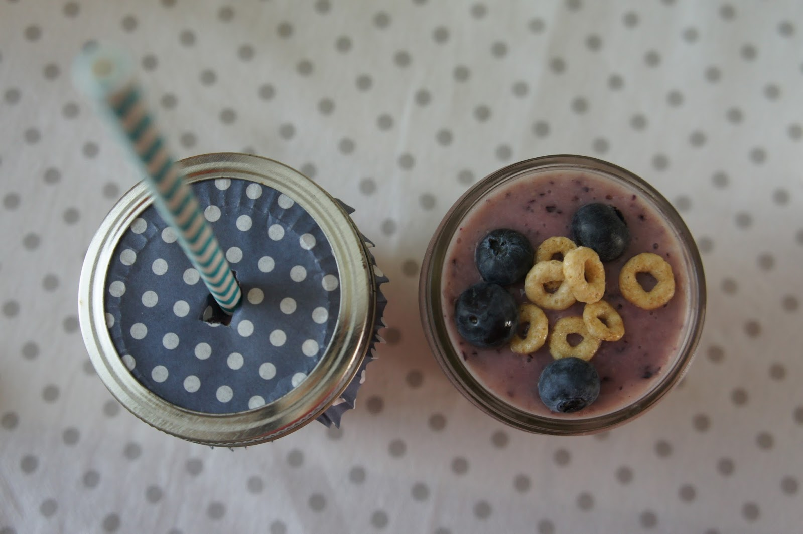 Use cupcake liners with small mason jars to serve smoothies to kids! Helps with spills and uses leftover cupcake liners! Try this gluten-free smoothie recipe!