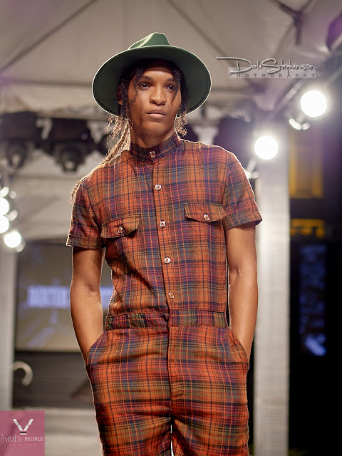 c2a72f71bc Model wearing plaid romper by Jamaican Designer Dexter 3D Pottinger at the  Jamaica Yellow Pages Fashion Show in 2016