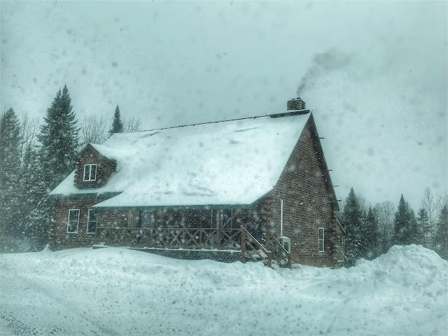 our log home in a snow storm