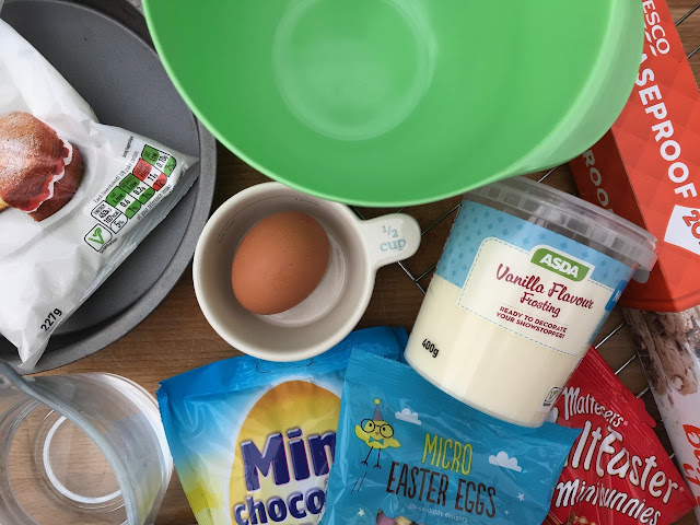 A picture showing ingredients and equipment to make a cake