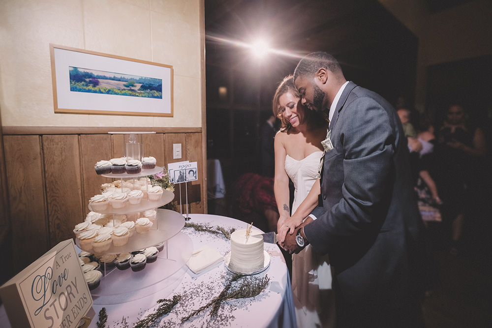 Cake cutting in Hillside Church wedding hall, El Cerrito, CA California