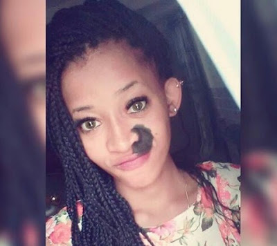 Photos: Meet beautiful Nigerian lady who has refused to cover up her dark facial birthmark