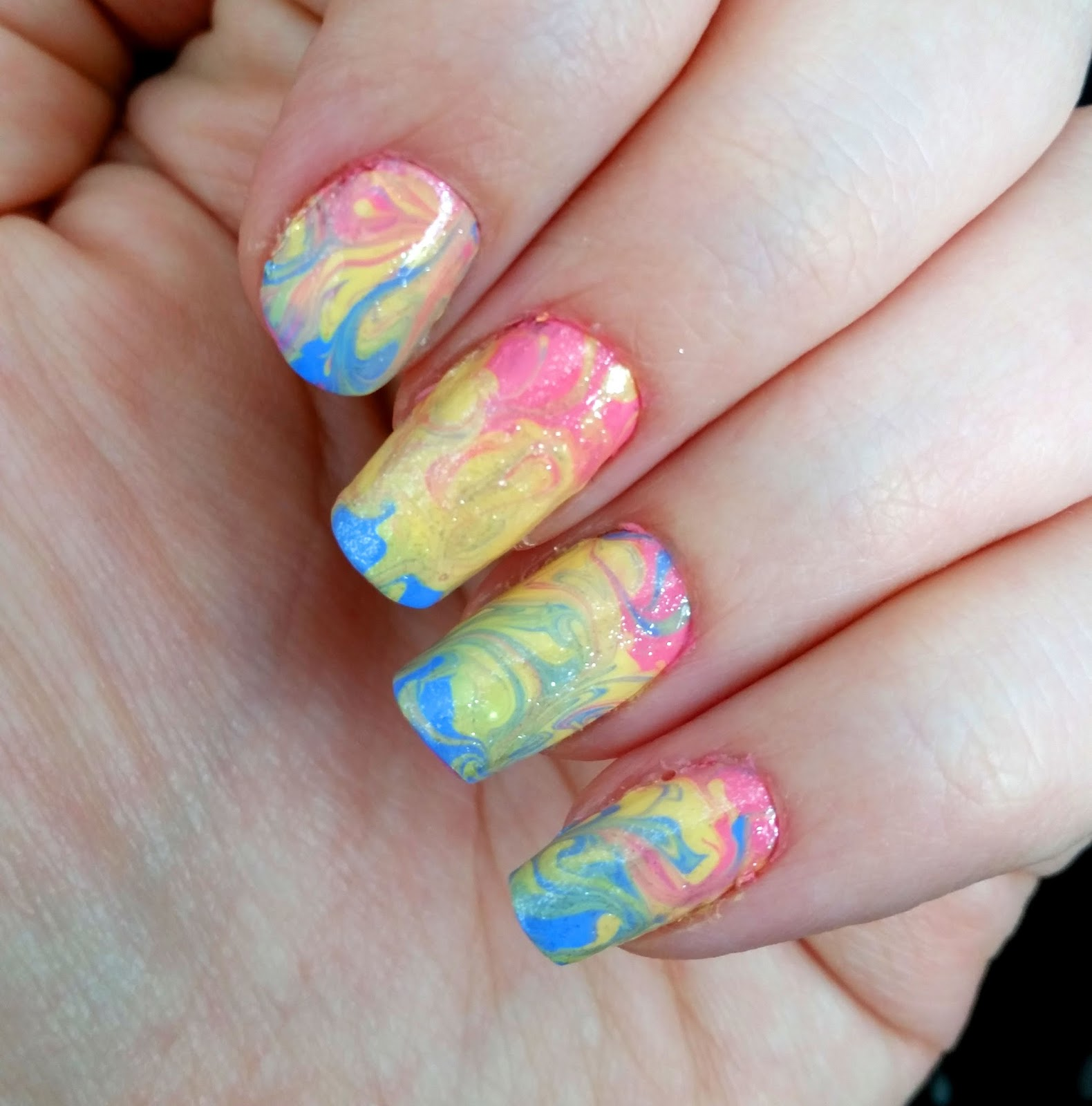 A mini tutorial on how to create watermarble nails using a cheat method