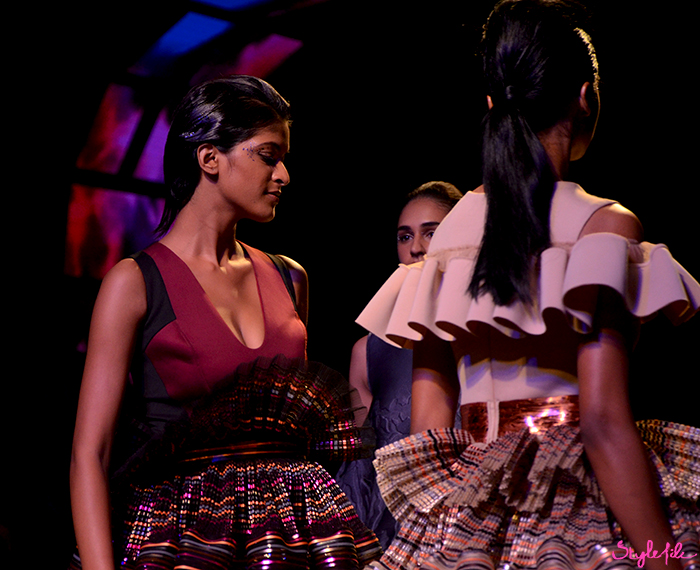 Models wear wet hair which is pulled back into a ponytail and pencil shaving ruffles for Amita Aggarwal at Lakme Fashion Week Summer Resort 2016 at St. Regis, Mumbai
