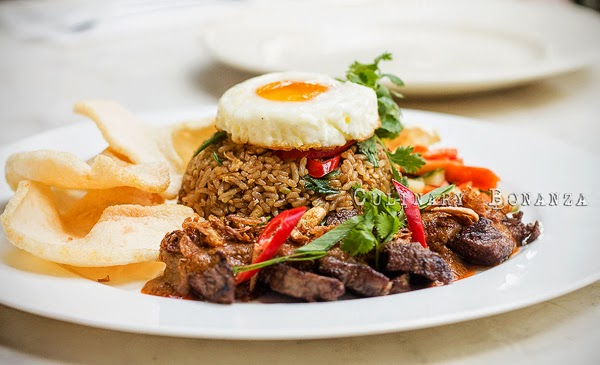 Wagyu Rendang Steak served with fried rice, fried egg, pickles and prawn crackers
