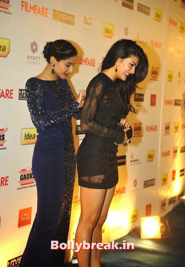 , Sonam Kapoor Fixing Jacquiline Fernandez's Dress at Filmfare Nominations Party - New Pics