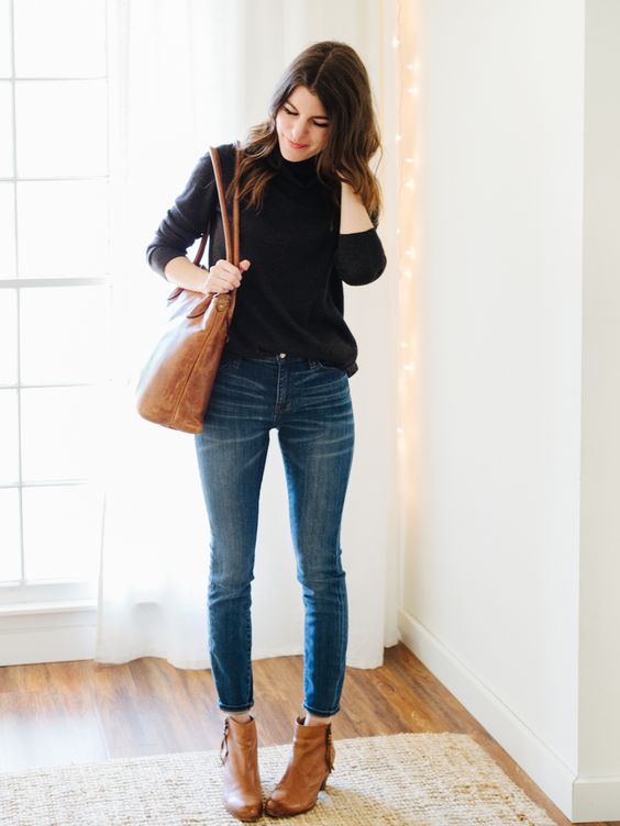 Street Style Simple Black Sweater A Pair Of Jeans Leather Ankle Boots And A Matching Handbag
