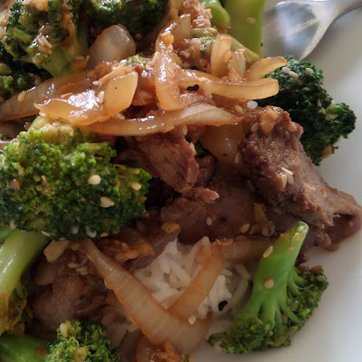 Beef and Broccoli Stir Fry:  Savory beef and crisp broccoli served over rice. Made with leftover steak.