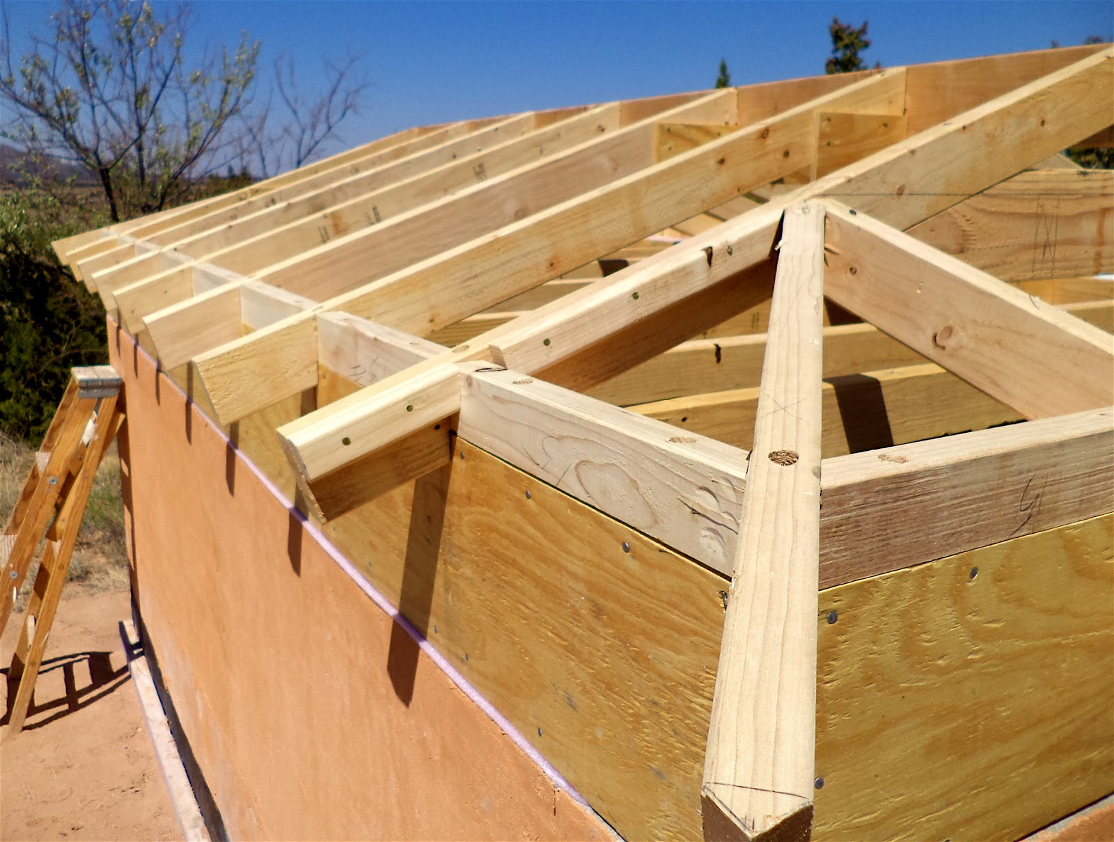 Alt build blog building a well house 4 framing the hip for Hip roof design plans