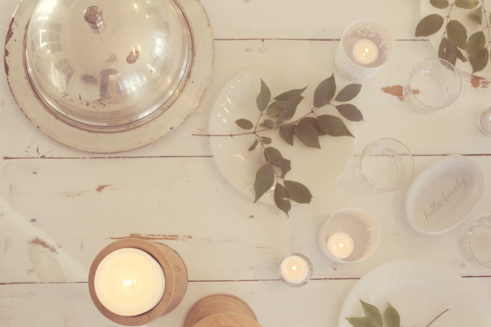Modern farmhouse slow living tablescape on white farmhouse table with candlelight