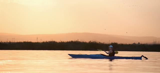 Sunset paddling on Lake Telincea; Danube Delta, Romania