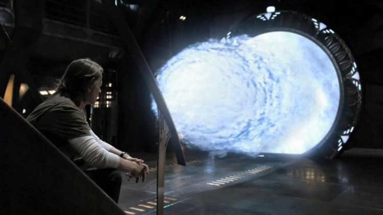 "Rush sits near the Stargate in SGU's ""Time"""