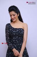 Telugu Actress Richa Panai Stills in One Shoulder Floral Long Dress at Rakshaka Bhatudu Movie Interview  0055.JPG