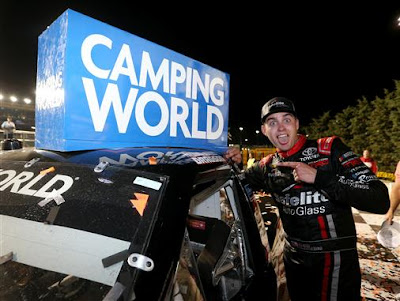 Noah Gragson, driver of the #18 Safelite Toyota, poses with the winner's decal  in victory lane after winning the NASCAR #NCWTS 37 Kind Days 250
