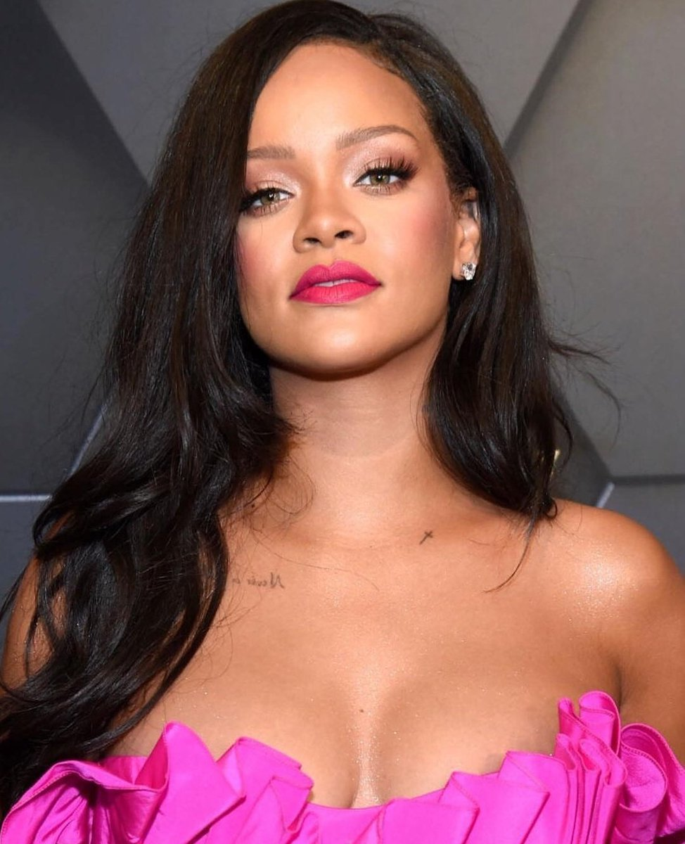 Rihanna dress was strapless and showcased a modest amount of her ample cleavage