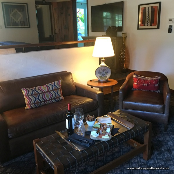 sitting area in guest room at Rancho Caymus Inn in Rutherford, California