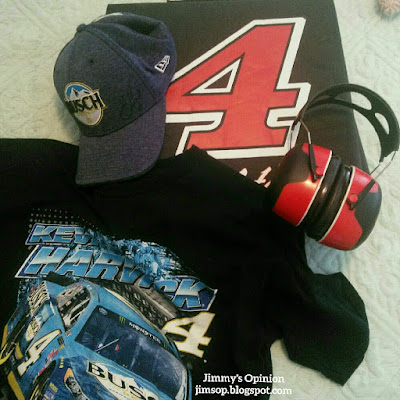 A Nascar Kevin Harvick t-shirt and hat with a #4 seat cushion and hearing protection to be used at the Auto Club 400 race