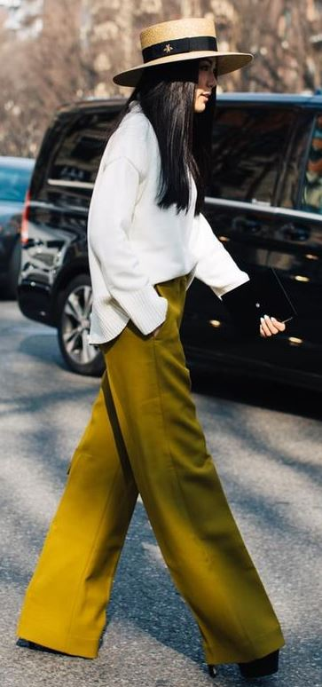 what to wear with a hat : white top + olive pants + bag + heels