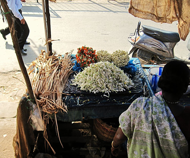 woman selling white flowers