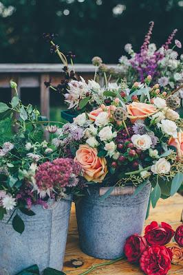 Flores en cubos de cinc