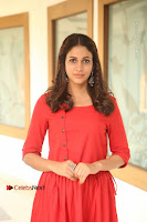 Actress Lavanya Tripathi Latest Pos in Red Dress at Radha Movie Success Meet .COM 0025.JPG