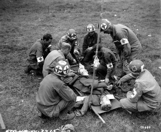 Medical team at work during the Battle of Normandy. WWII combat medic and field medicine. Angel's Glow. marchmatron.com