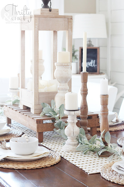 tablescape on wood table with candlesticks