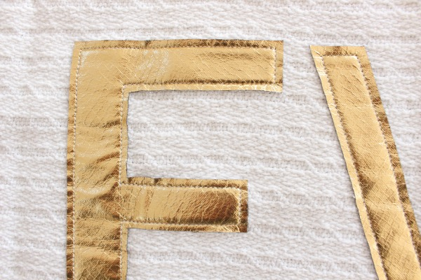 top stitch gold letters in position