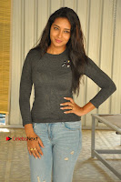 Actress Bhanu Tripathri Pos in Ripped Jeans at Iddari Madhya 18 Movie Pressmeet  0057.JPG